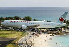 Planes landing at the Princess Juliana Airport, St. Maarten - Air Canada.