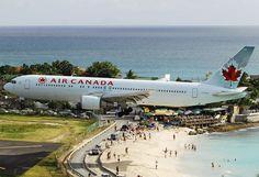 Planes landing at the Princess Juliana Airport, St. Maarten - Air Canada.