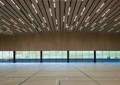 Timber walls feature narrow slices at Virdis' Lussy Sports Hall