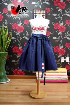 A modernized, mini fusion hanbok.  I'm saving up to buy one right now, because I think these are adorable.  And I could make it work for wearing to a wedding.