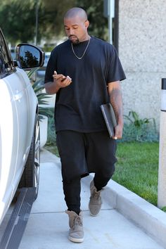 Kanye is once again seen here wearing all black that draws emphasis from the black to the Grey and Gum sole Yeezy Boost 750.