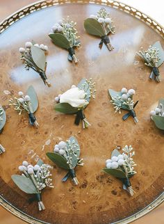 Boutonnieres with a blush tea rose, silver brunia and eucalyptus leaves | @rebeccayale | Brides.com