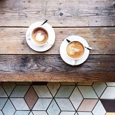 #coffee under wood table, like a vintage film.