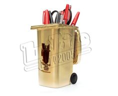 COMING TO YOU IN THE SUMMER TIME - Following the success of our original Wheelie Bin, we thought we'd have a revamp! So now we can offer you Gold Wheelie Bin! There's just something about this version that smacks of bling and we love it! You can stick your brand new Wheelie Bin on your desk as a pen pot, in your kitchen for the peelings or anywhere else for that matter! The Wheelie Bin can hold just about anything small so your pencils, tools, batteries, vegetable peelings,
