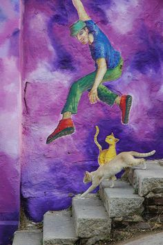 Real Cat is not impressed by Graffiti Cat. The Jump - Valparaiso, Chile.