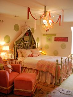 Sweet Greens  Pink and green hues are an eye-catching color duo and add to the whimsical feel of this girls' bedroom. RMS user sljdesign used interchangeable plaid and green fabric for the elegant bed crown, creating a bo… more