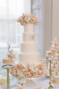 The details on this cake are beautiful! #roses #flowers #pink #cake #macarons #desserts #wedding #weddingday #weddingcake #details #cakedetails #weddingphotography Photographed By: #mangostudios