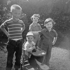"""In December of 1955 we went to visit my Grandma Wilkins and """"Uncle Torchy"""" in Torrance CA. From L to R: Torrey Wilkins Jim Evans (in stroller) Nancy Evans (with the lovely sunglasses) and Kay showing who is boss with her hand on Jim's head!"""