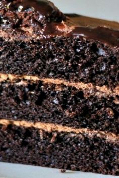 This rich, delicious One Bowl Chocolate Cake (from scratch) is perfect for every occasion and won't leave your kitchen a wreck because you only mess up one bowl! #recipes #cheesecakerecipe #dessertrecipes #cookierecipes #chocolatecakerecipe #carrotcakerecipe #easycakerecipes #cupcakerecipe #bananacakerecipe #lasagnarecipe #easydessertrecipes