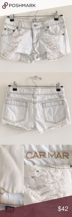 """Carmar 100% Cotton Distressed Cutoffs Size 24 Super cute shorts with on-trend distressing.  Features zip fly & 5 functional pockets 😎  Stats (laying flat): Inseam: about 1""""   Front rise: about 7""""   Waist: 14""""   100% cotton  Pre-owned, with some signs of wash & wear + faint stain on back pocket (pictured)   Machine wash cold   No trades Carmar Shorts Jean Shorts"""