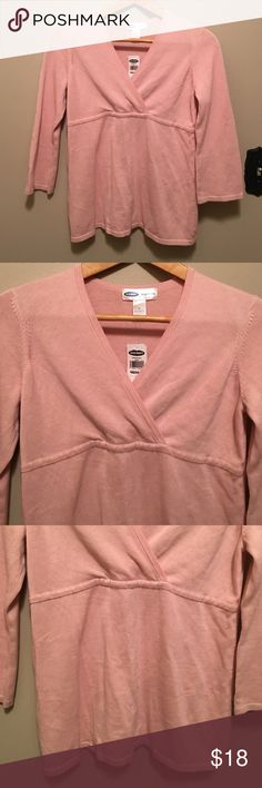"""Old Navy maternity M pink V-neck tunic sweater Feminine, flattering, and comfortable NWT V-neck tunic style pink maternity sweater from Old Navy features V-neck wrap front empire waist three-quarter length sleeve's and is a cotton acrylic blend. Dimensions taken while garment is laying flat: 34"""" bust, 32"""" waist, 38"""" hips. 19"""" sleeve length and length from shoulder to bottom hem 24"""". Old Navy Sweaters V-Necks"""