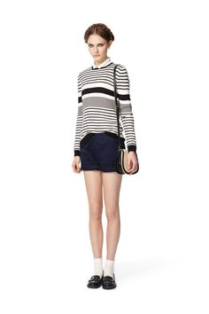 Look 14: Long-Sleeved Sailor Sweater in Black/Cream Stripes, $32.99 Long-Sleeved Blouse in White with Black Ribbon, $34.99 (Available at Target.com only) Also Available in Blush with White Dots Cuffed Shorts in Navy, $26.99 (Available at Target.com only) Woven Mini Saddle Bag in Cream, $24.99 (Available at Target.com only)