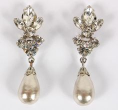 """Henry Schreiner vintage costume jewelry pearl and rhinestone earrings with baroque pear shaped faux pearl drop, ca. 1960. Rhodium plating on brass. 2 1/2"""" long. Excellent condition."""