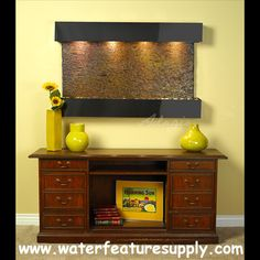 This indoor Sunrise Springs wall hanging water fountain will make your office a hit.  All of my friends compliment my freestanding water feature; I would recommend this company to anyone who is looking to add a fountain to their interior space. Please visit us at http://www.waterfeaturesupply.com/waterfalls/sunris-springs-marble-wall-water-feature.html to learn more about the Sunrise Springs.