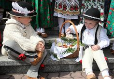 Getting ready to bless the food @ Easter in traditional Polish costumes (which are worn only for special occasions)