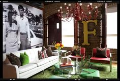 what an eclectic living room! red chandelier, large photo & huge letter cut-out, love it.