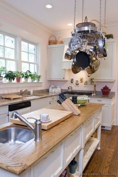 #Kitchen Idea of the Day: Cottage Kitchen with hanging pot rack over the furniture-style wood-topped island.