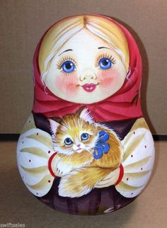 "Russian traditional toy ""Nevalyashka"" is a wooden roly-poly bell doll. #folk…"
