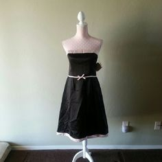 NWT Black Strapless Dress Brand new, with tags.  Sisters by Kathlin Argiro.  Black strapless dress with pink mid bow and pink trim.  Size 12.  100% polyester.  35 inches long. Kathlin Argiro Dresses Strapless