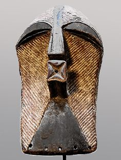 Songye Kifwebe Mask. Kifwebe masks were used for healing, initiations, funerals and witchcraft. Early 20th century.