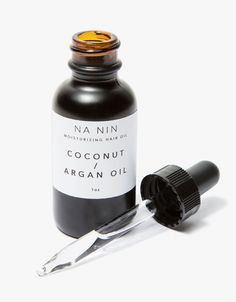 From Na Nin, a moisturizing hair oil that uses coconut oil, argan oil, neroil and geranium essential oils to hydrate dry hair.  • Moisturizing hair oil • 1 oz • Made in USA  Ingredients • Organic fractionated coconut oil • Neroli essential oil •