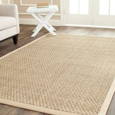 <li>Highlight your home decor with a hand-woven natural fiber rug</li> <li>Casual rug features a natural background with a beige border</li> <li>Natural seagrass area rug is innately soft and durable</li>