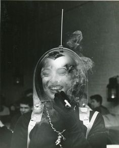 Woman in a Space Helmet Smoking a Cigarette - Fotograaf: Arthur Fellig (Weegee) Space Girl, Space Age, White Photography, Street Photography, Weegee Photography, Comics Illustration, Barbarella, Atomic Age, Vintage Photos