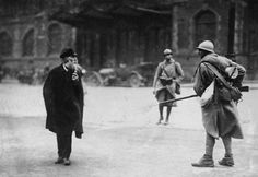 French soldier confronts an elder German civilian during the occupation of the Ruhr area, 1923