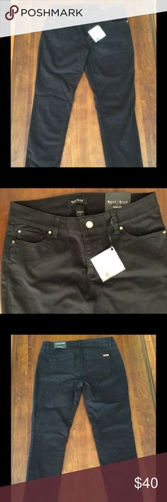"""NWT WHITE HOUSE BLACK MARKET Black Skimmer Pants WHITE HOUSE BLACK MARKET St. Honore jean collection.  It is soft brushed cotton, ankle fit with signature rhinestone rivets at pockets and ankles.  96%cotton, 2% Spandex.  Please note:  The color in the photos did not turn out.  These are jet black. The last 2 photos demonstrate best the actual color!  Approximate measurements taken flat and un-stretched:  Waist: 15.25"""" Hip: 17.75"""" Rise: 8.5"""" Inseam: 28"""" Leg opening: 5.5"""" White House Black…"""