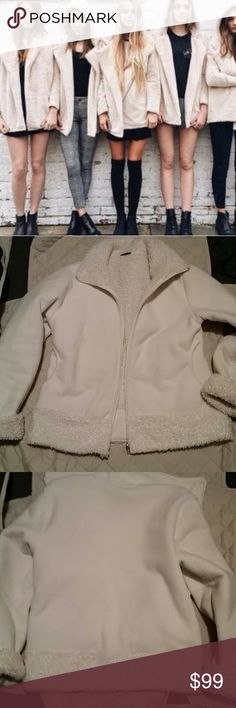 Sandra coat size large First picture is the same line of coats being modeled. This is in great condition size large off-white color extremely soft and beautiful. Unsure of the material. sandra Jackets & Coats
