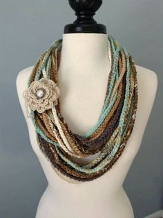 BLENDED TEXTURES AND COLORS.Single crocheted infinity necklace scarf in multi colors. Several different types of yarn and ribbons have been Más Crochet Scarves, Crochet Shawl, Knit Crochet, Fabric Jewelry, Fabric Necklace, Crochet Gifts, Cute Crochet, Knitted Necklace, Finger Knitting
