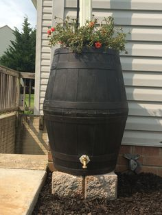 DIY Rain Barrel made from resin planters. Check out how we made it at http://sherrirobbins.net/2014/07/29/diy-rain-barrel/