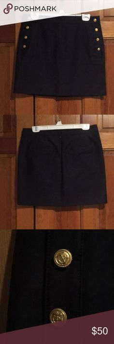 JCrew navy mini skirt Navy skirt with gold anchor buttons, front pockets and zipper in back. Worn once so it is in excellent used condition. Comes from a smoke free and pet free home. J. Crew Skirts Mini