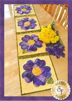 Patchwork Pansy Table Runner Pattern: Create a darling table runner for spring! Designed by Jennifer Bosworth of Shabby Fabrics, this design features patchwork - a great way to use up scraps! - and applique.