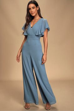 The Lulus Bow For Love Slate Blue Flutter Sleeve Jumpsuit will be causing butterflies when you glide across the room! Woven Georgette jumpsuit with tie details. Flattering Bridesmaid Dresses, Velvet Bridesmaid Dresses, Affordable Bridesmaid Dresses, Bridesmaid Dresses Online, Bridesmaid Jumpsuits, Dresses For Less, Types Of Dresses, Casual Dresses, Blue Jumpsuits