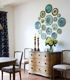 Mismatched blue plates on wall