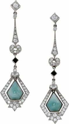 Diamond, Jade, Onyx, Platinum Earrings. Each dangling earring features jadeite jade and black onyx cabochons, enhanced by European-cut diamonds, set in platinum.