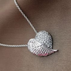 Angel of True Love Necklace is designed to create a minimalistic yet enchanting appeal on every woman. This half-heart half-angel wing pendant connotes a woman's lively spirit and vibrant heart that fly on angel's whim. In this stunning pendant, the vibrancy of half-heart half-angel wing design makes a stylish embellishment, which no one will be able to get their eyes off!