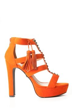 "Edgy can be Colorful too ""Pyramid Studs and Tassel Heel"" the cool bronze accent pyramid studs and tassels for a chic edge for your going outfit! Check them out on www.cicihot.com for more great heels for this spring and summer! #CiCihot #love #tassels #heels #pyramidstuds #studs #orange"