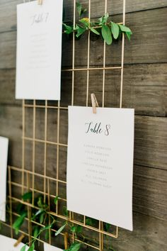 Gold and greenery escort card display: Photography: Amanda Nippoldt - http://www.amandanippoldt.com/