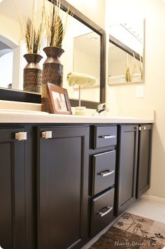 Painting Bathroom Cabinets  Clean, Sand, then Wipe with Liquid Deglosser  Prime – Zinsser Oil Based  Paint – Black Magic in Satin by Olympic  Top Coat – Poly by Varathane in Semi Gloss  from the blog Navy Bean Lane