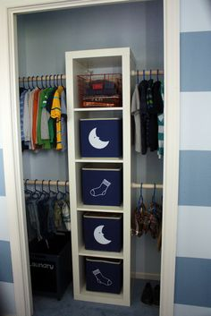 Ikea Expedit bookshelf and inexpensive dowel kits to create built in children's closet storage. Custom label PJ and sock holders, too!