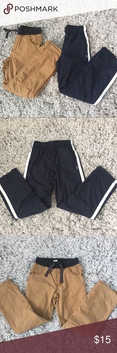 Gymboree boys pants, size 8, 2 pair Excellent like brand new condition, worn once! Jersey lined dark khakis & jersey lined navy blue active pants are perfect for your little boy's closet! Gymboree Bottoms Casual