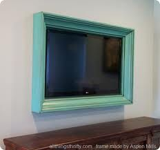 tv framed in barn wood - Google Search Cute idea for an iPad in the kitchen. Or small tv.