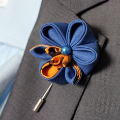 A personal favourite from my Etsy shop https://www.etsy.com/listing/186155651/royal-blue-and-orange-brown-eco-orchid