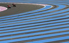 Riders take a curve during qualifying sessions for the 79th Bol d'Or motorcycle endurance race at the Paul Ricard circuit in Le Castellet, France, on September 18, 2015. The Bol d'Or 2015, a 24-hour motorcycle endurance race, will take place at Le Castellet on September 19-20, 2015.