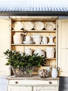 Interiors - Kara Rosenlund  Lovely display of white dishes and ironstone adding charm to any home!