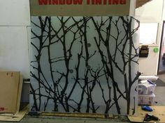 Decorative Film Installation on a Storm Window in Shop, Installed by Spokane Sunscreen