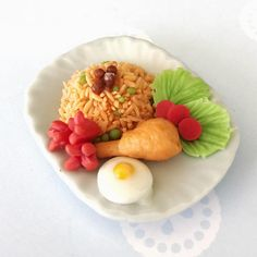 Miniature American Fried Rice on the plate Miniature for dolls house collection. Its really realistic. Material : Polymer Clay, Ceramic Plate Size : 3.8x4.9CM. ---- Payment Policy ---- Payment is due immediately upon purchase using Paypal Account ---- Shipping Policy ---- - The