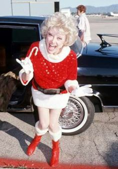 Merry Xmas!  Legendary Comedian Phyllis Diller arrives for the taping of Bob Hope's USO Christmas From the Persian Gulf (1988)